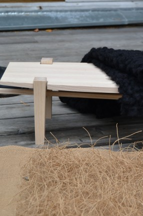 Bench with rug in the paper. Designer Mikael Löfström. Textile from Twistin'